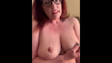 Red head milf with glasses shows off her big tits.