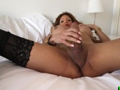 Busty stockinged shemale masturbates