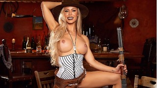 Watch american cowgirl Nicole Aniston striptease and play with her fingers