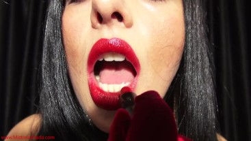 Dangerously red: Goddess Ezada putting on lipstick