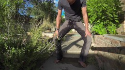 Pissing grey jeans in the backyard