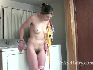 Lydia has fun stripping naked by her washer
