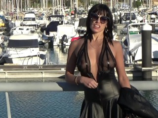 Brunette without panties walks in the seaport, pisses and masturbates