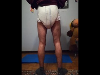 Diapered boy poop his diaper