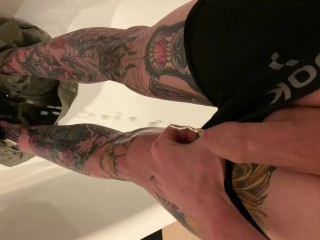 Tattooed guy desperate wetting taking off shorts and boxers