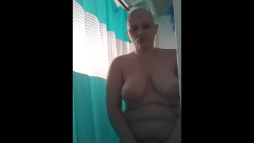 Naughty bald girl in the shower