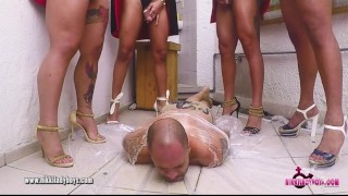 The Human Piss Tornado with 14 T-girls pissing over a dude