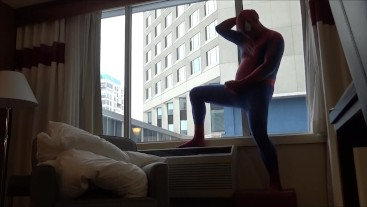 spiderman shows his hard cock to office workers from his hotel room