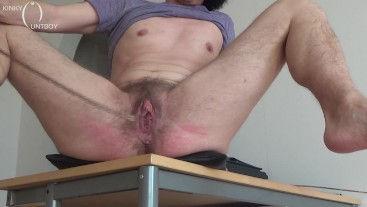 Arousing hairy pussy caning on a desk corner