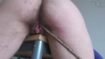 Hairy pussy caning on a desk corner 2