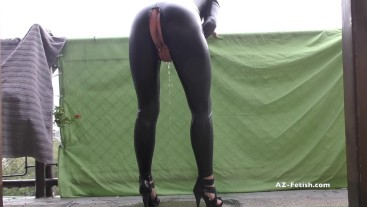 Pee on balcony above bar in latex suit and high heels