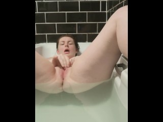 MILF plays with her wet clit in the bath…whilst hubby is just downstairs!