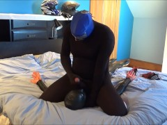 lucha masked black spandexed wrestler humps his orca dummy