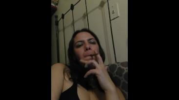 femdomme smokes in bra