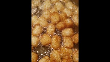 Greasy nasty lil tater tots in hot oil bath FOODPORN