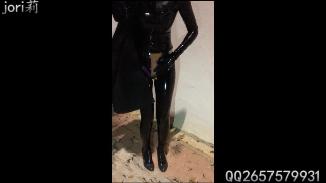Latex womens wear Latex girl wearing vibrator and walking outside