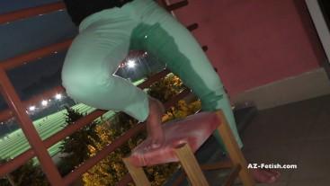Desperation pee on public balcony when watch footballl game outdoor