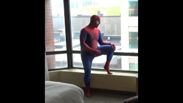 spiderman showing his hard cock at window