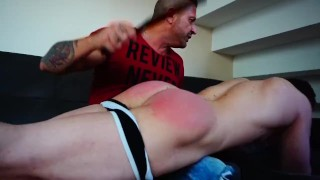 Daddy spanked and paddled this young jock's bubble ass good