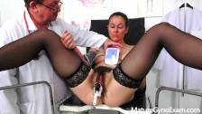 Hot MILF Valentina Ross gyno exam of her hairy muff + vaginal irrigation