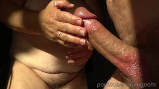 BBW oily handjob in the afternoon sun. Nice thick flowing cumshot.