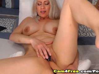 Sexy blonde cutie fucking her vulva with dildo