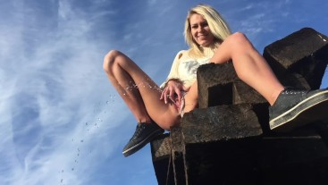 Claudia Macc is playing with her pussy in public and peeing