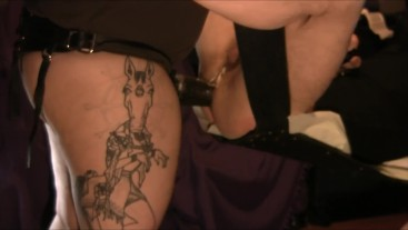 Tattooed Domme Gives Her Guy A Pegging With A Large Cyborg Strapon