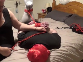 Very Big Ass And Pussy Man Hogtied And Gagged By Woman On Bed And Struggling To Get Free