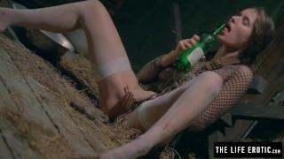 Girl is chained in a dirty basement masturbating with a bottle