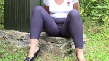Handcuffed Angela peeing in jeans leggings.