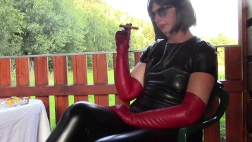 Cigar smoking in leather and dirty tongue