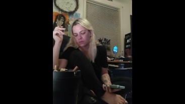 Girl smokes and plays on phone, silver nails