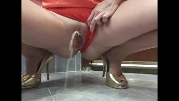Desperate pee in red satin panties and ball dress