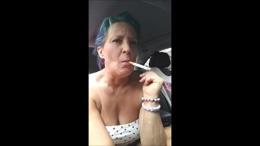 MILF SEXY SMOKE IN THE CAR