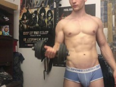Chris Wild doing biceps curls and masturbates his big cock