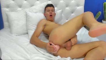 HORNY BOY PLAYING WITH A BIG DILDO IN ASS AND SPILL A BIG LOAD OF CUM