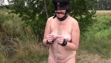 Pissing in leather handcuffs