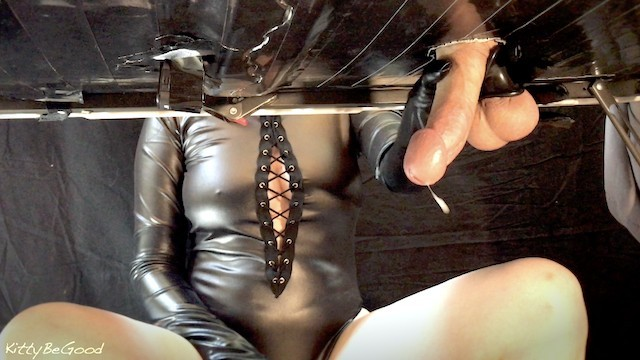Leather bondage equipment Mistress sensually milks big cock with leather gloves