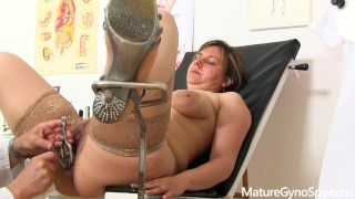 Hidden cam recording of young chubby MILF on her gyno exam