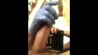 Hung tattooed stud jerks till he blows wearing gloves(cumshot closeup)