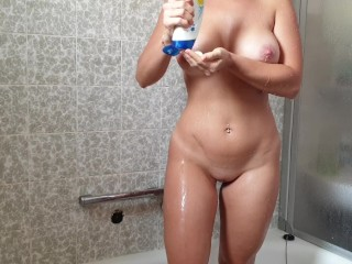 Lovely big boobs young babe masturbates in the shower