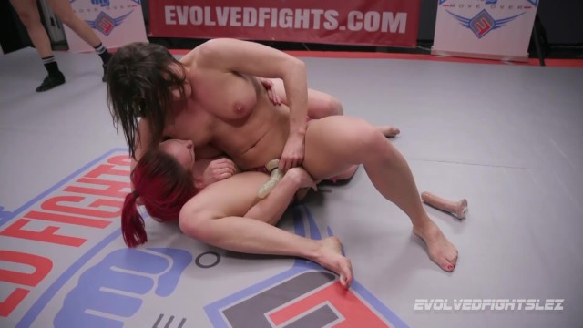 Ariel X Dominates Bella Rossi in Lesbian Wrestling Match with strapon sex