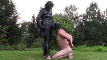 Mistress Angela in a leather coat and slave (Dressage and blowjob of my str
