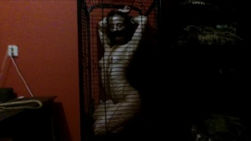 Young slave girl in cage