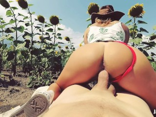 POV Outdoor Cowgirl riding in a field of sunflowers
