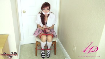 Redheaded School Girl Struggles in Rope Blondage For Fun