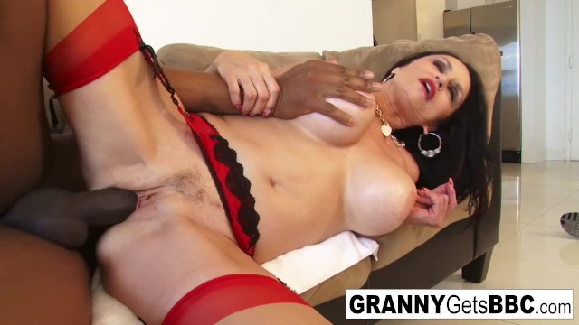 Busty brunette granny takes the black cock in her wet pussy