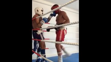 Boxers in full gear kiss from and punch