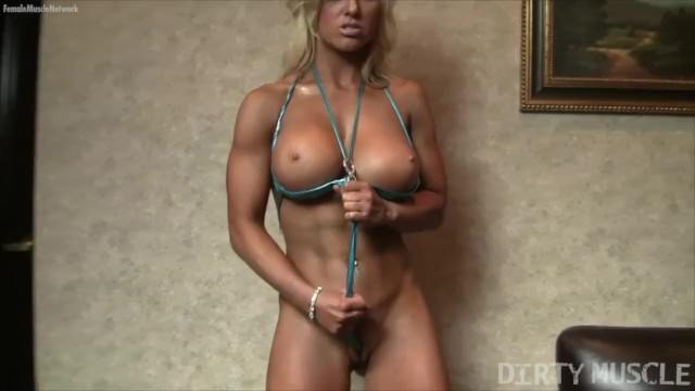 Teenie weenie string bikini - Blonde muscle barbie poses in a string bikini and gets wet